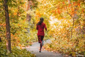 A woman on her morning jog in a trail in Palo Alto.