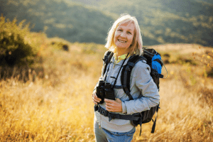 A healthy woman hiking in a trail in Los Altos.